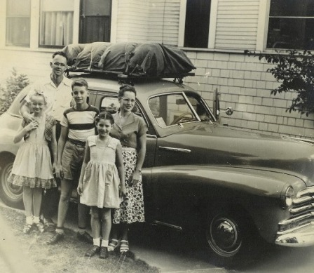 Robert and Margaret Stone and their children, including Sue Ellen in front, with their new Chevy, circa 1950